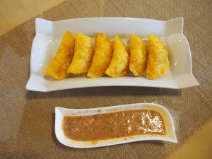 Empanadas de Pipián - filled with potatoes and served with a spicy peanut sauce